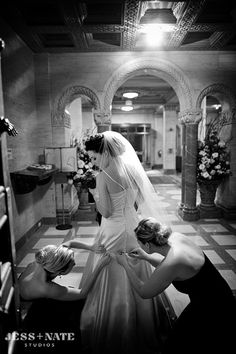 great shot with bridesmaids/MOH helping bustle the dress