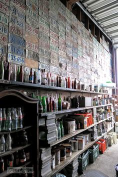 License plate and old bottle collection, at Granny and Grumpa's Antiques | funkyjunkinteriors.net