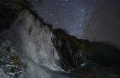 Our home galaxy, The Milky Way and our neighbour, The Andromeda Galaxy, shines in the starry sky of the World Heritage site of Mount Siguniang of China. Being one of the biggest icefalls in the area(height:50m; wildth 20m), it gets frozen up from November to May, making itself the paradise for ice climbers country-wide.  By Jeff Dai, via Flickr