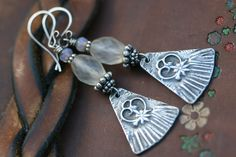 Rustic Bohemian Jewelry Floral Charm earrings n40- Invicit charm . frost glass . earthy . ethereal . white glass earrings . earthy  jewelry by Tribalis on Etsy https://www.etsy.com/listing/249744198/rustic-bohemian-jewelry-floral-charm