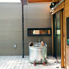 Steel trough turned outdoor tub