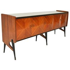 Italian Modern Sideboard | From a unique collection of antique and modern sideboards at http://www.1stdibs.com/furniture/storage-case-pieces/sideboards/