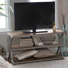 Belham Living Edison Reclaimed Wood TV Stand - A rustic beauty, the Belham Living Edison Reclaimed Wood TV Stand brings industrial glamour to your home theater. This rugged TV stand includes a genuine...$299