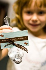 "our wedding favors. ""a spoonful of love & some hugs & kisses. Now we're Mr & Mrs."" spoon is full of hershey kisses"