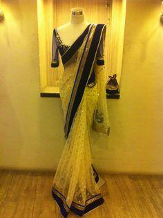 Golden saree with blue border .