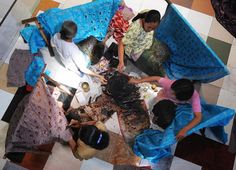 Batik craftswomen apply melted wax to fine cotton textiles to produce characteristic figurative designs at a workshop in Solo city in Central Java, Indonesia on June 29, 2009. (ROMEO GACAD/AFP/Getty Images)