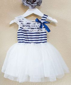 Fusing trendy stripes with a flouncy skirt, this adorable dress was designed with style and comfort in mind. Its tank top keeps little limbs enjoying those fair-weather breezes, while the soft blend of fabrics couldn't feel more divine.