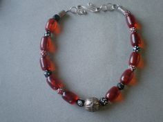 Hey, I found this really awesome Etsy listing at https://www.etsy.com/listing/115787060/red-amber-beads-with-yemenite-soldered