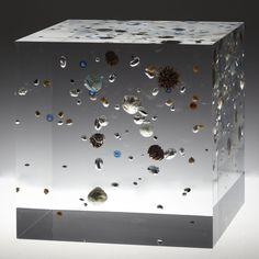 Satoshi Hirose, Beans Cosmos (2013), Acrylic resin, map, plastic, beans, gold, beads, glass beads, nuts, fruit of kumquat, 25 × 25 × 25 cm