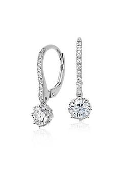 Timeless and feminine, these drop earrings feature brilliant round diamonds framed in 14k white gold with diamond accented leverbacks.