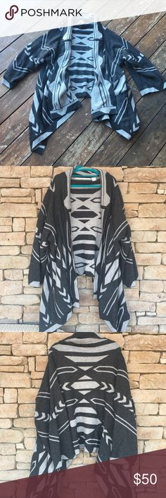 12th Street Vincent Blanket Sweater Super warm and comfortable Twelfth Street by Cynthia Vincent blanket sweater size Medium. This is OVERSIZED. Will fit multiple sizes comfortably! Dry clean only (please note small stain on right sleeve edge). Last photo is what this sweater looks like in a different pattern on Khloe Kardashian. ⭐️POSH ONLY⭐️ Twelfth Street by Cynthia Vincent Sweaters