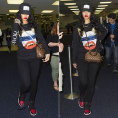 Rihanna wearing Pigalle snapback cap, Trapstar x Monster Tour longsleeved t-shirt, Air Jordan 1 sneakers.