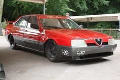 """Alfa Romeo 164 Pro-Car, site quote: """"Alfa started by stripping the interior down to the bare essentials, including the disposal of the rear seat.  The engine was also changed, and moved to the space left over by the back seats.  In place of the standard four-cylinder engine, Alfa dropped in a 3.5L V10, putting out 620hp from the factory.  This engine was originally intended for Formula One racing, so in the stripped 164, which only weighed 750kg, it was quite a difference"""""""