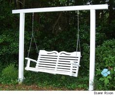 Garden Swings on Freestanding Wooden Swing Seat In A Garden Painted Bright White And