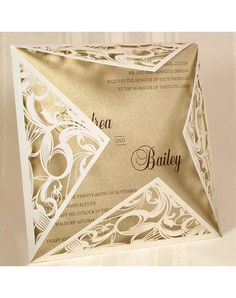 Off-white shimmer laser cut couture invitation