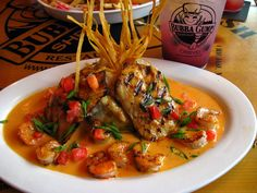 Bourbon Street Mahi Mahi:   Charbroiled Cajun spiced mahi mahi with bourbon sauce and grilled shrimp, served over mashed potatoes (drink: blueberry lemonade)