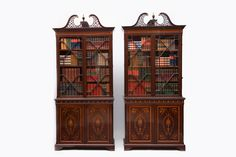 A MAGNIFICENT PAIR OF EDWARDIAN INLAID MAHOGANY BOOKCASES CERTAINLY BY
