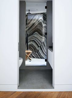 The Mercury black-marble slab that lines the shower stall was one of the first things Heckman purchased for the apartment—at the time he didn't know what he'd do with it, just that he had to have it. The other bathroom walls are covered in a finish inspired by Axel Vervoordt's use of concrete in Belgium.  Photo: Annie Schlechter