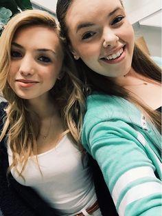Peyton snaps a selfie with co-star Miranda may