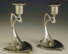Manufacturer: WMF. Designer: unknown. Description: Pair of Art Nouveau silver plate on pewter & brass candlesticks. Country of Manufacture: Germany. Date: 1906