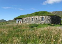 Gorgeous Green-Roofed Black Sheep House Looks Out to Sea