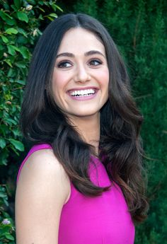 Emmy Rossum Long Wavy Cut - Emmy Rossum looked lovely at the Rape Foundation's annual brunch wearing her hair in high-volume, center-parted waves.