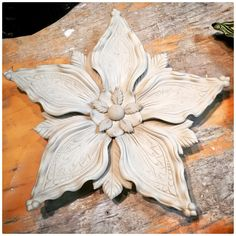 One of Sarah's wall flowers fully assembled and drying. . . . . #clay #ceramics #deco #flowerart #handbuilding #porcelain #wip #makersgonnamake #potterymaking #art #wallsculpture #wallart