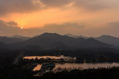 West Lake is surrounded on three sides by 'cloud-capped hills' and on the fourth…