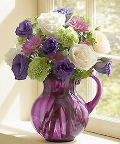 love this container with these flowers in it...