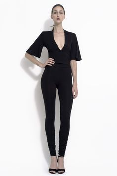 Plunging V-neck blouse waist length with bell sleeve made with bamboo spandex jersey. Available in black and off white.