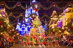 """On select evenings at Magic Kingdom Park, Mickey's Very Merry Christmas Party gives guests the chance to experience exclusive special holiday entertainment, including """"Mickey's Once Upon a Christmastime Parade."""""""