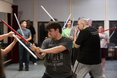 James Neese, center, is pictured during the lightsaber class, held at Ripley-Grier Studios in April. Some experts cite popular culture franchises like 'Star Wars' to explain the appeal of lasers. New York Jedi - photo credit WSJ.com