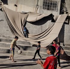 Children playing soccer at the Faawar refugee camp in the West Bank. Photo: Adam Ferguson