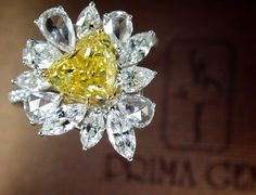 Prima Gems presents you a magnificent 1.53 ct Vivid Yellow Diamond Ring