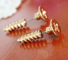Screw earrings/posts. LOVE! I would love an industrial like this too… Or maybe an industrial shaped like a nail? oooo