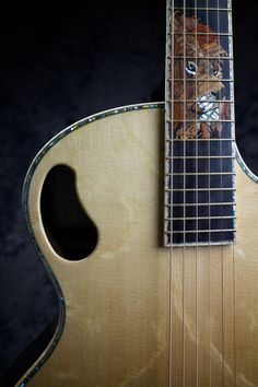 """Lion inlay in a """"Da Vinci"""" model by Driftwood Guitars Guitar Building, Ukulele, Driftwood, Guitars, Lion, Music Instruments, Model, Leo"""