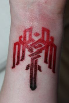 """Funny, really... I see all the Fallout and Star Wars tattoos, and think """"sheesh, that's ridiculous..."""" This, on the other hand, is from Dragon Age. So it's cool."""