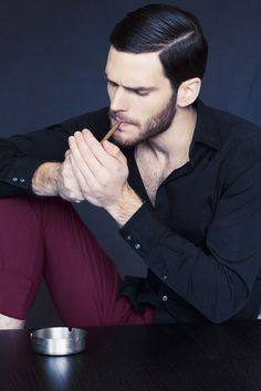 I love the complete look, his pants, shirt, hair, beard and smoking that cigar. Hot and very masculine!!!