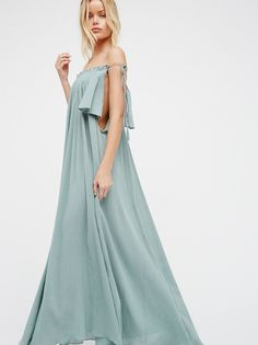 Natasha Maxi Dress | Made from our sheer and gauzy Endless Summer fabric, this effortless off-the-shoulder maxi dress features flouncy sleeves and a ruffled smocked band at the neckline with an adjustable side tie for the perfect fit. Throw on top of a bikini or layer over one of our seamless styles for a perfectly layered look.  * Hidden side pockets   * Simple, shapeless silhouette