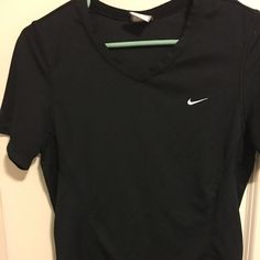 Nike athletic tee Nike fit dry tee shirt size medium 8-10. Material tag cut out so this is 8/10 preowned condition and excellent shape otherwise. Not your average tee shirt feel. This is great for working out. Nike Tops Tees - Short Sleeve