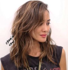 Medium Shag Haircut With Long Side Bangs
