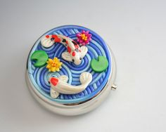 This would make a great cake design - in fondant/ gum paste/ modeling chocolate instead of fimo -Koi Pond Pill Box in Polymer Clay Filigree via Etsy