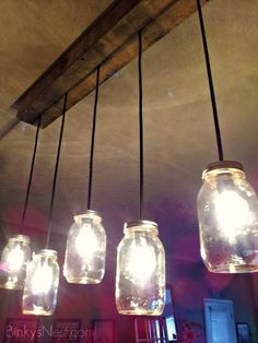 Mason Jars Island light-  I like the rustic wood feature that hides the cords.  Might be fun to utilize this idea with conventional, single pendants used in a row in lieu of Mason jars.