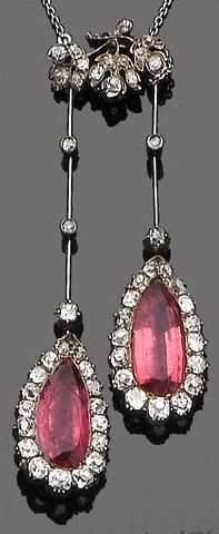 A pink spinel and diamond negligée pendant, circa 1900 Each pear-shaped mixed-cut pink spinel within an old brilliant-cut diamond surround, suspended from articulated knife-edge bars collet-set with old brilliant-cut diamonds, to a similarly-set foliate surmount and a trace-link chain, diamonds approx. 3.00ct total, lengths: pendant 6.9cm, chain 46.5cm
