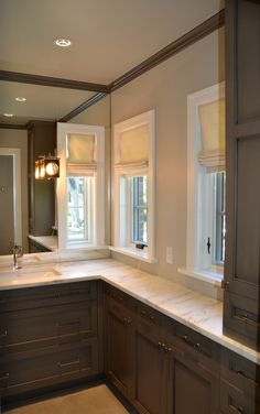 BKC Kitchen & Bath master bath remodel: Crystal Cabinets, Hampstead door style, Mushroom paint with a black highlight.