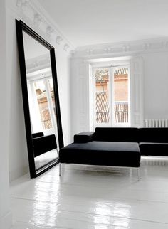 Large black framed mirror  ...I'd use a different couch...but this look is gorgeous!