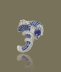 A SAPPHIRE, SYNTHETIC SAPPHIRE AND DIAMOND BROOCH Modelled as a channel-set calibré-cut sapphire, synthetic sapphire and circular-cut diamond cornucopia with oval-shaped sapphire centre.