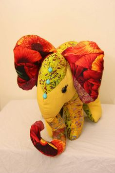 I made this little girl for a friend, who immediately called her Yellophant!   I love the colours in this toy.  www.patchworktoad.com