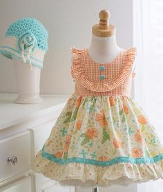 NEW 2017 Girls handmade Clementine Dress. Lovely shades of aqua and orange on a creamy color floral background fabric. Details include: Flutter Sleeves Sewn-in Sash Cotton Fabric Made in the USA. Published using Nembol Frocks For Girls, Little Girl Dresses, Girls Dresses, Baby Frocks Designs, Kids Frocks Design, Girls Frock Design, Girl Dress Patterns, Toddler Dress, Kids Fashion