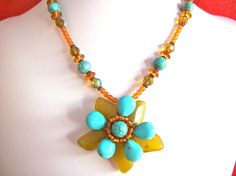 Gemstone flower necklace wire wrapped with green and by StarJewels, $68.00
